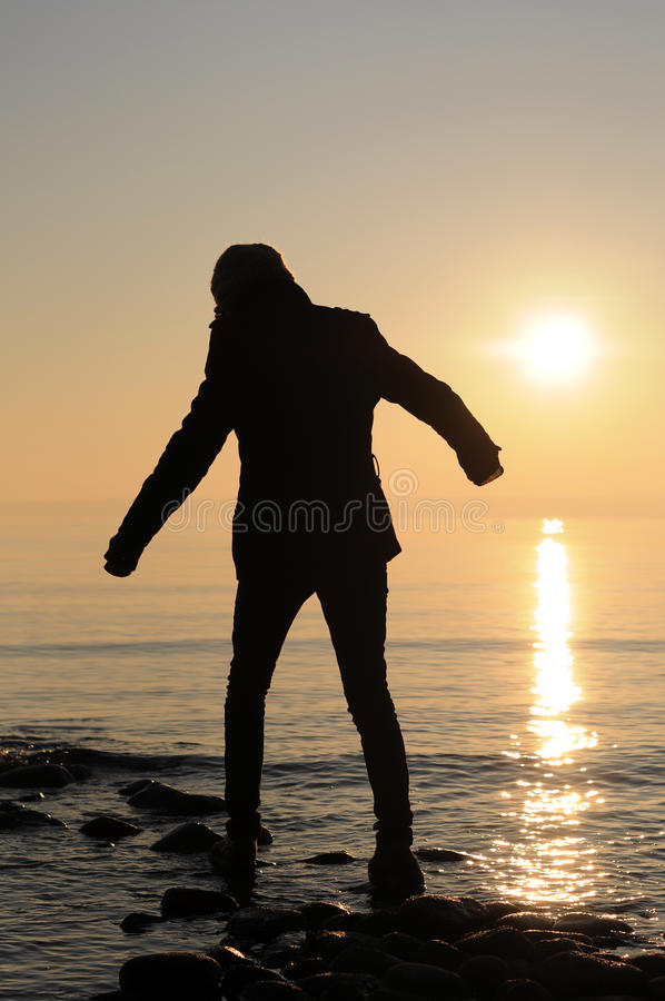 Man Balancing On Stones In Lake Stock Images