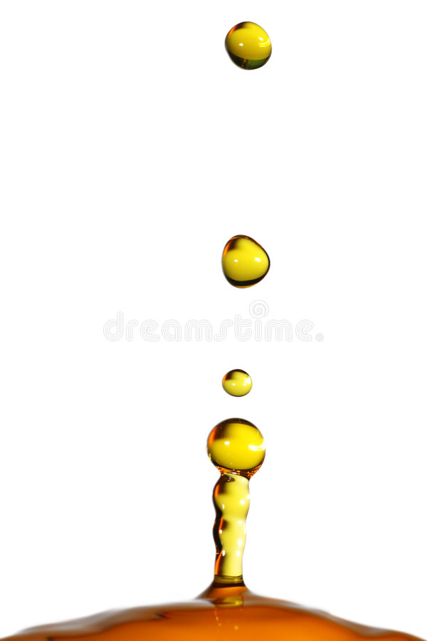 Balance. Colored water droplets frozen in time stock image
