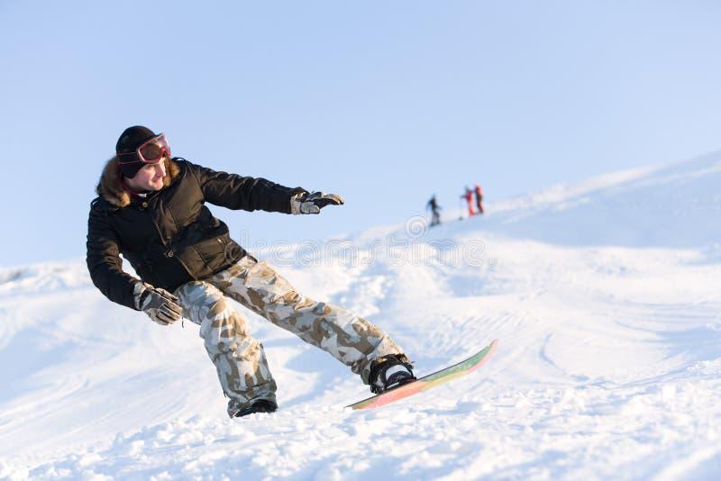 Balance. Image of sportsman go snowboarding at free time stock photo