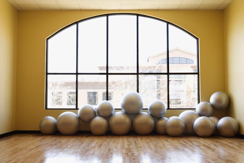 Balance Balls on Floor in Gym stock photos