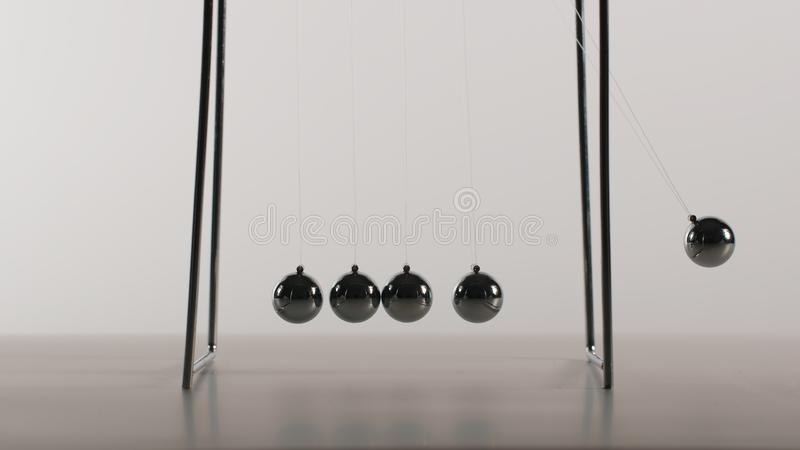 Balance balls is swinging - Front view royalty free stock photography