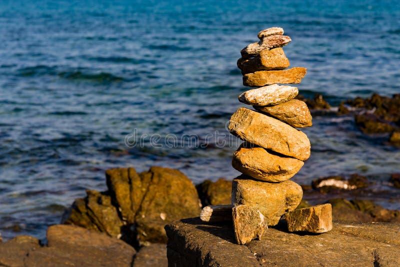 Balance stack stone on seacoast stock photo