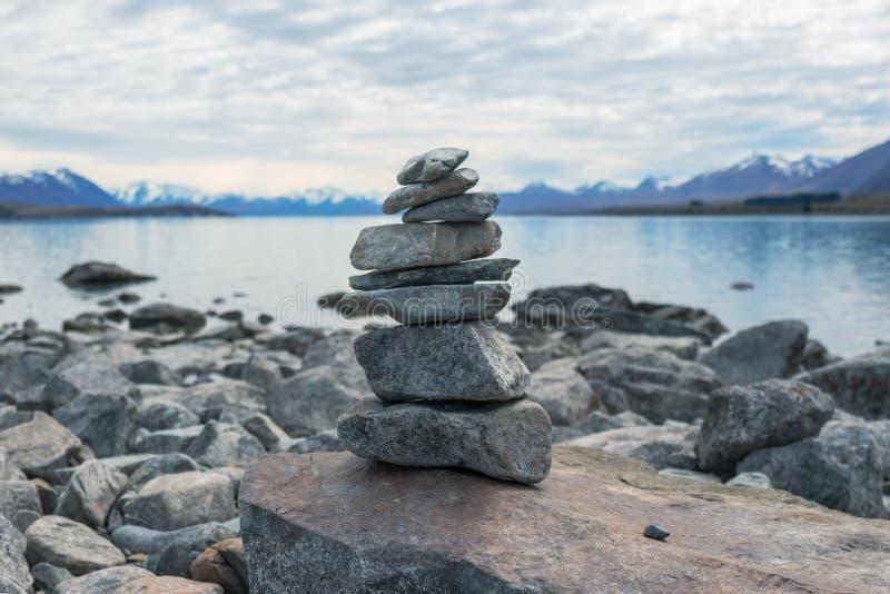 Balance stone pyramid  at Tekapo lake, New Zealand royalty free stock photos
