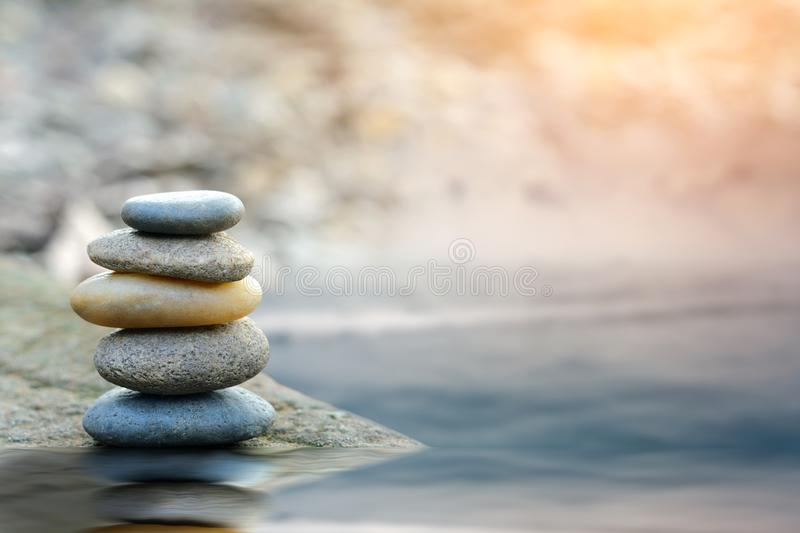 Balance stone with spa on river stock photo