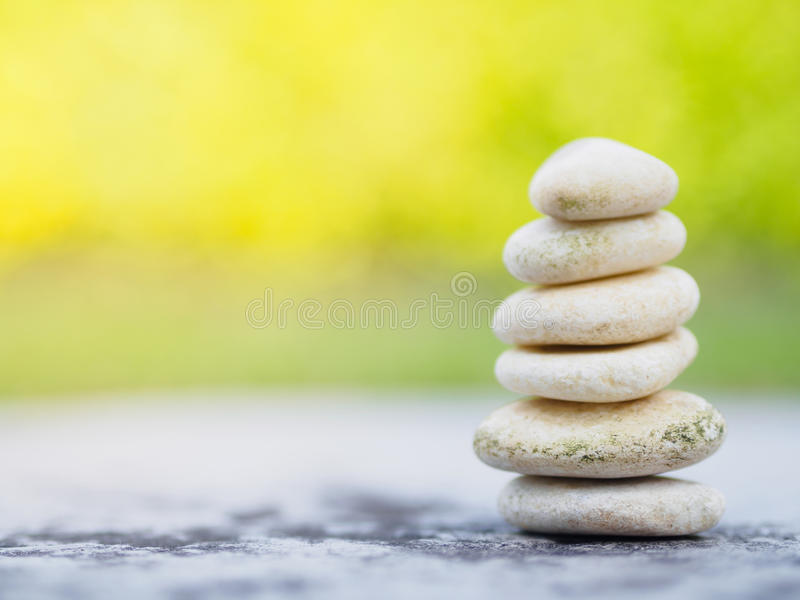 Balance Stones stacked to pyramid in the soft green background stock image