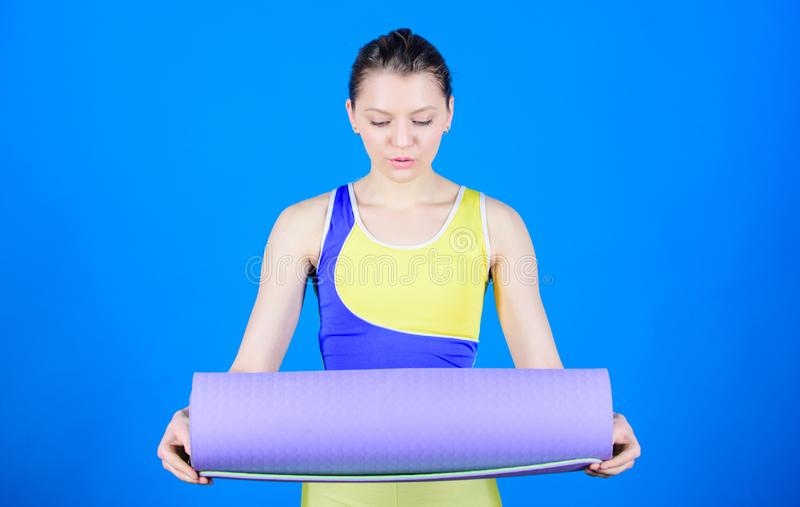 Balance your life. Yoga as hobby and sport. Practicing yoga every day. Girl slim fit athlete hold fitness mat. Fitness stock images
