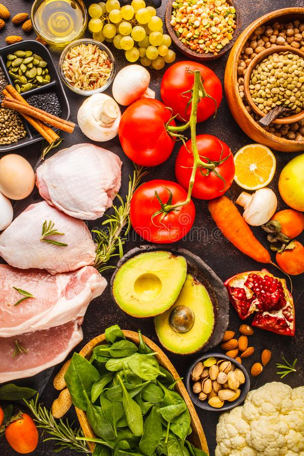 Balanced diet food background. Healthy ingredients on a dark background, top view. stock photo