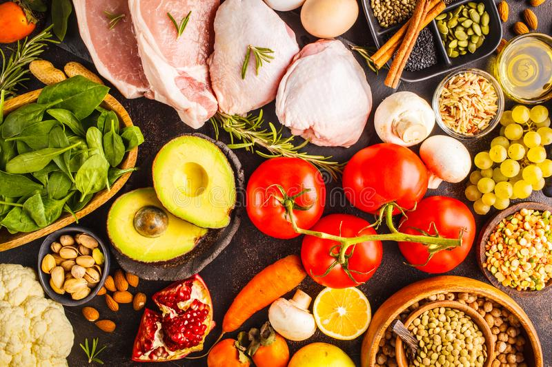 Balanced diet food background. Healthy ingredients on a dark background, top view. royalty free stock image