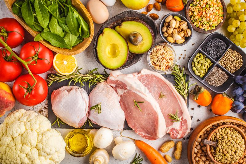 Balanced diet food background. Healthy ingredients on a white ba stock image