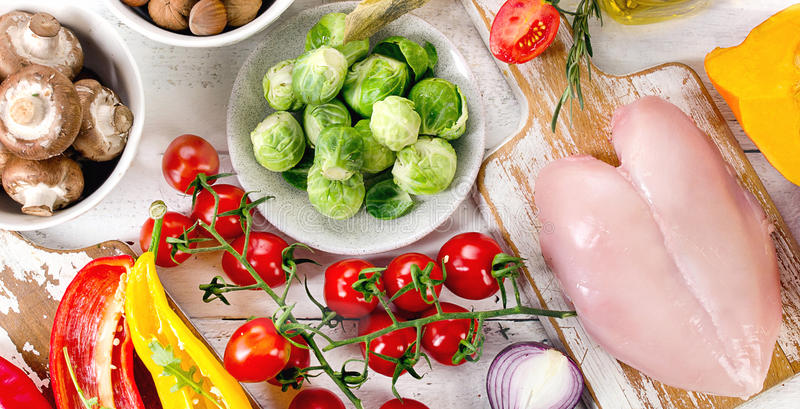 Balanced diet food concept. Fruits, vegetables and chicken meat. On wooden table. Top view stock image