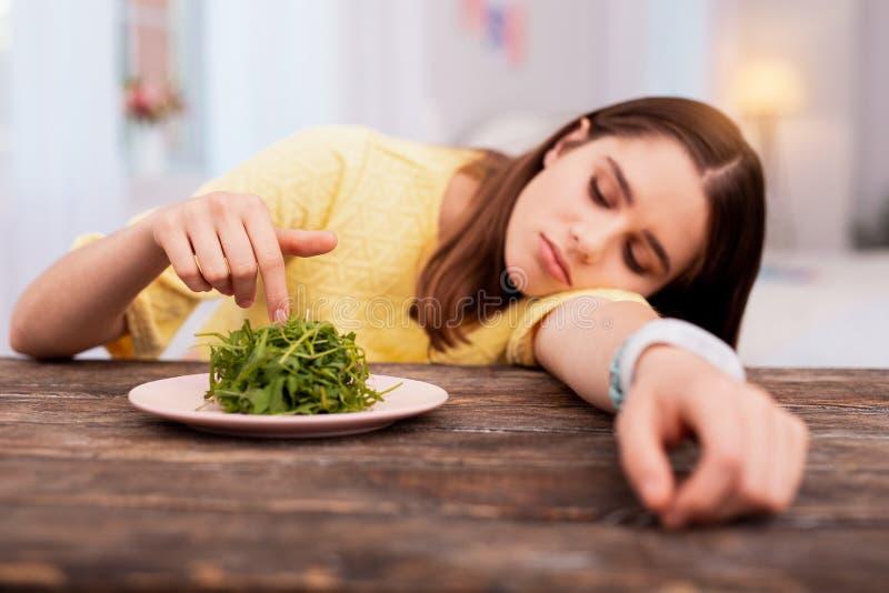 Bored teen girl eating healthy stock photography