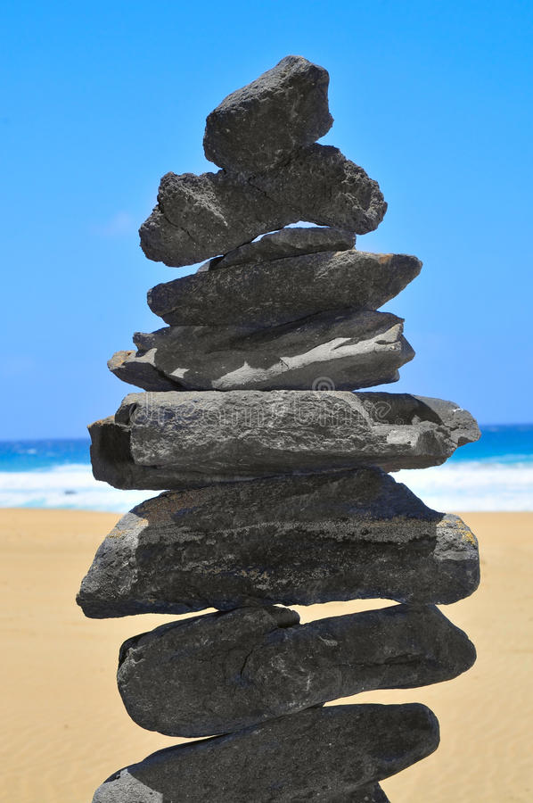 Balanced stack of stones. Closeup of a balanced stack of stones on a beach royalty free stock photos