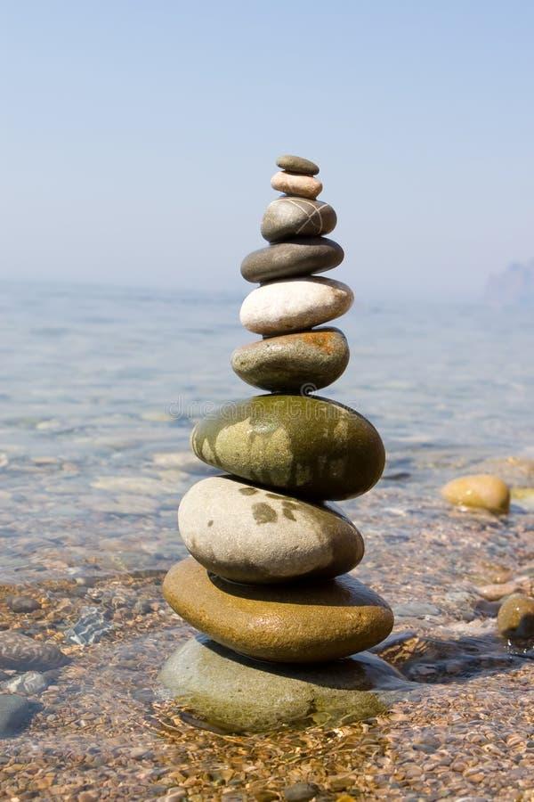 Balanced stones. On the sea stock photography