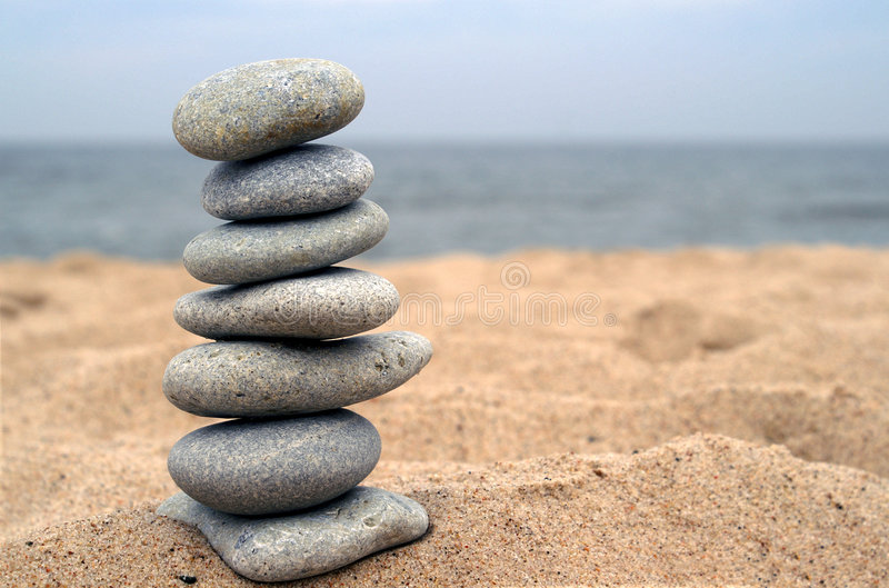 Balanced stones on beach stock photos
