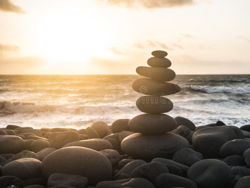 Balanced stones. On a beach at the ocean relax sun sunlight calm royalty free stock images