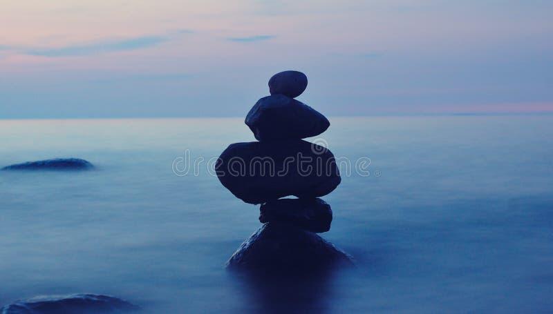 Balanced stones in sea stock photo