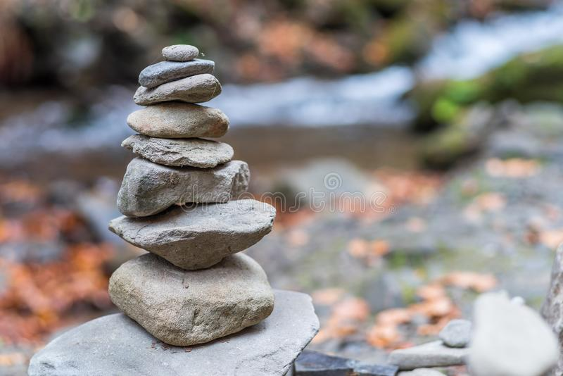 Balanced stones or stone pyramid on the river bank.  stock image