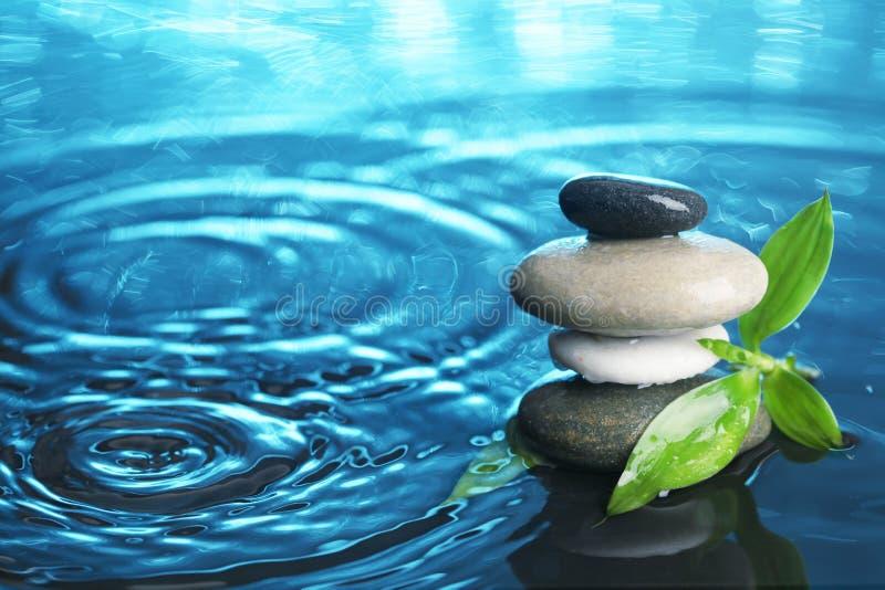 Balanced stones in water stock photo