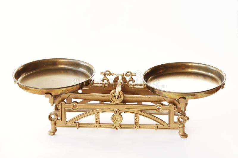 Balanced weight scales. View on brass scales on the white background royalty free stock images