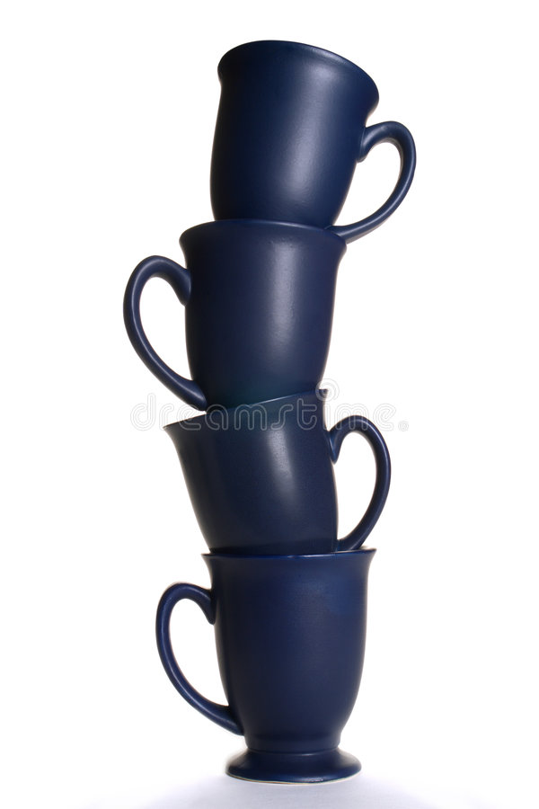 Balancing Act with Coffee Mugs over White stock photo