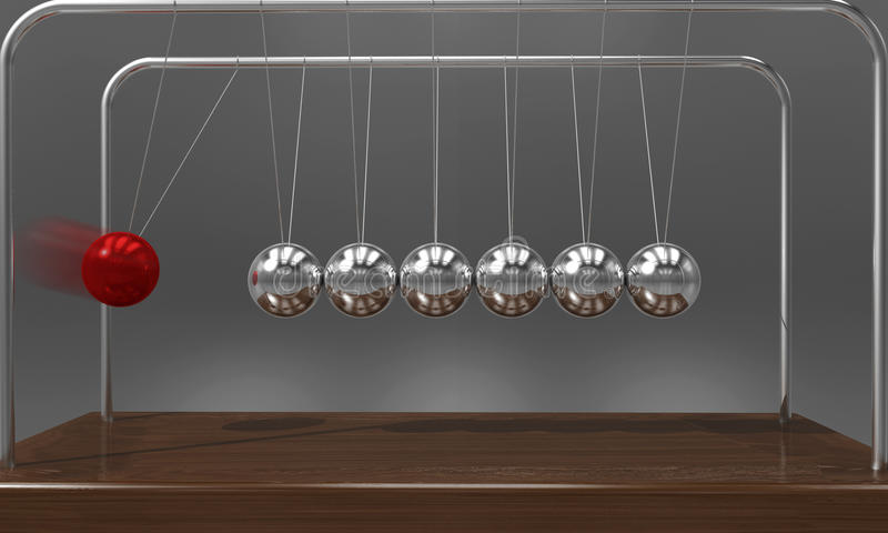 Balancing ball Newton`s cradle pendulum with motion blur over dark background royalty free stock photo