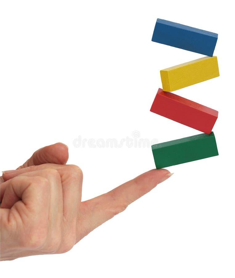 Balancing Blocks on Finger stock photography