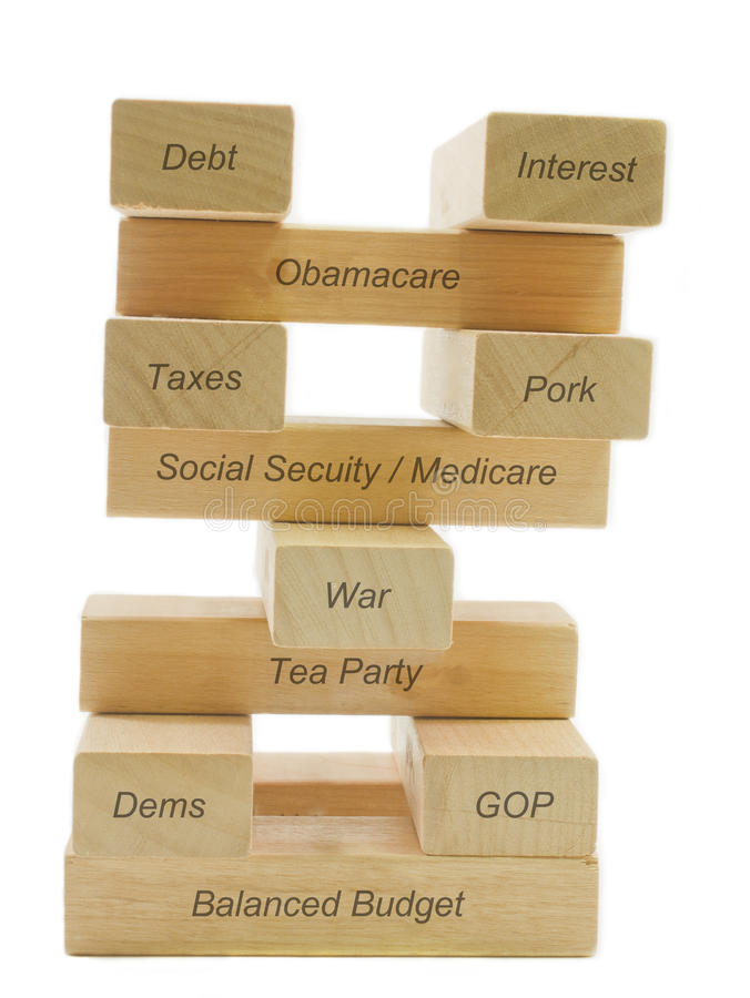 Balancing the budget. A concept of balancing the budget showing different factors balancing on wooden blocks including dems, gop, taxes, pork, tea party, war royalty free stock photos
