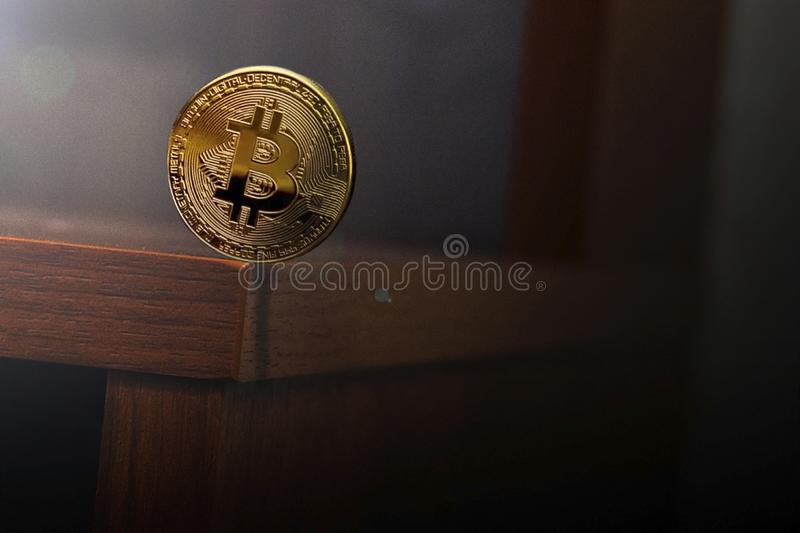 Balancing coins around the edge of the table. stock photography