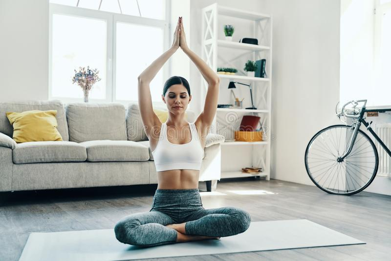 Balancing her mind and body. royalty free stock images