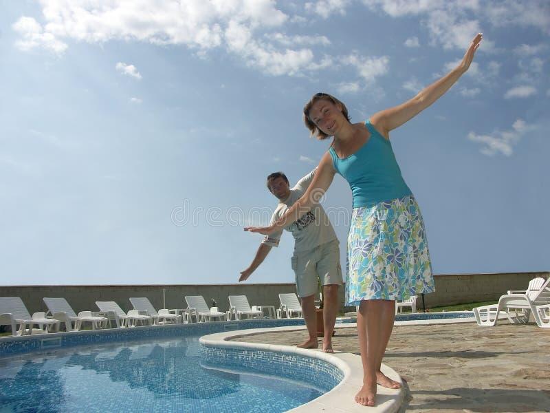 Balancing at the pool royalty free stock photo