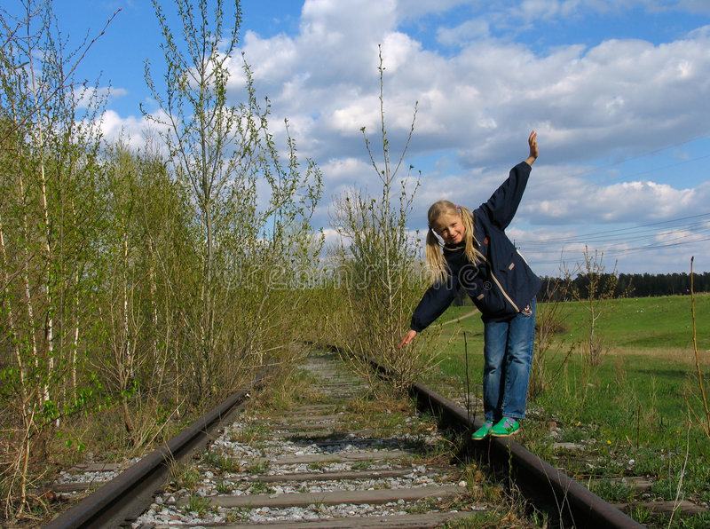 Balancing on rail royalty free stock images