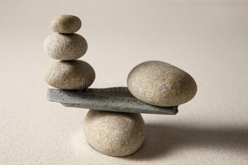 Balancing stones. On sand background royalty free stock images
