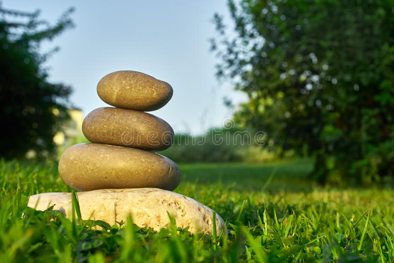 Balancing stones on the grass.  stock image
