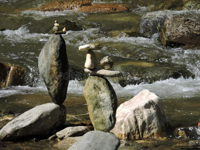 Balancing stones on a river. Bank. These stones are placed like this by hand and are not glued together in any way royalty free stock photos