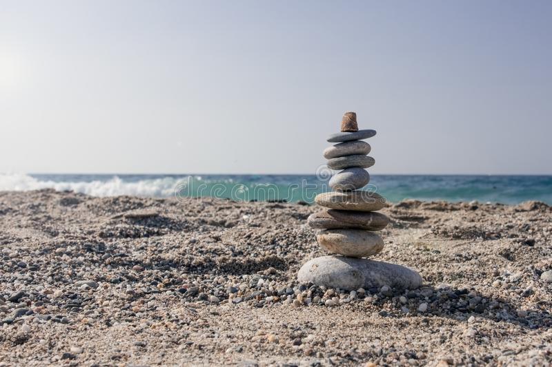 Balancing stones set one on top of the seashore. In summer stock images