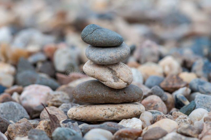 Balancing stones. Small balancing stones sitting on other rocks stock photo