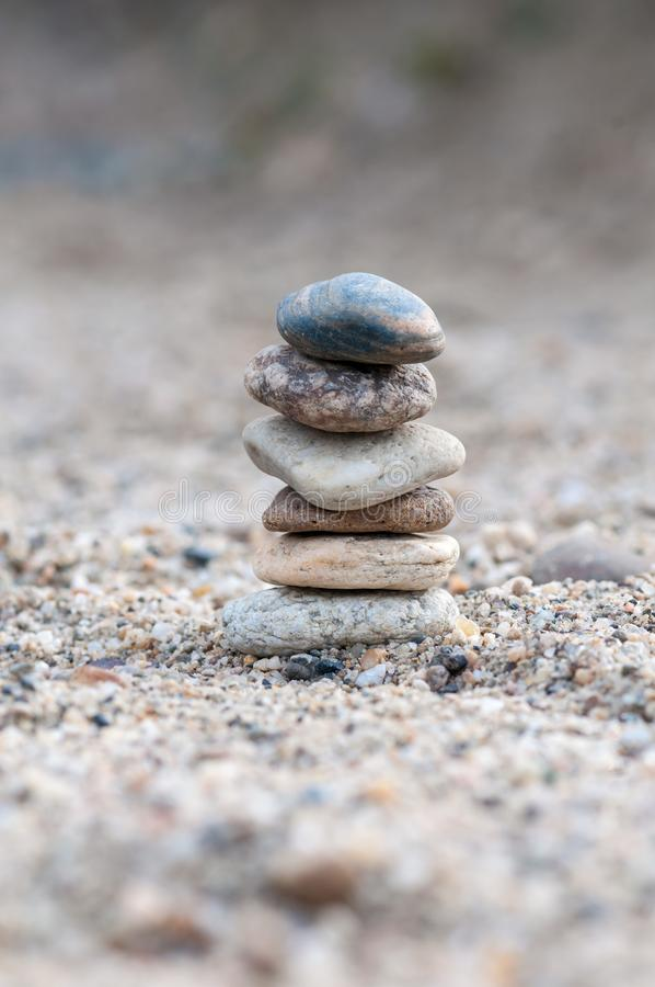 Balancing stones. Small balancing stones sitting on other rocks royalty free stock images