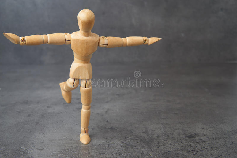 Balancing wooden mannequin, puppet, with copyspace. For creative concepts stock images