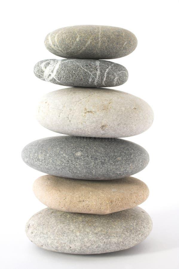 balansera pebbles arkivfoto