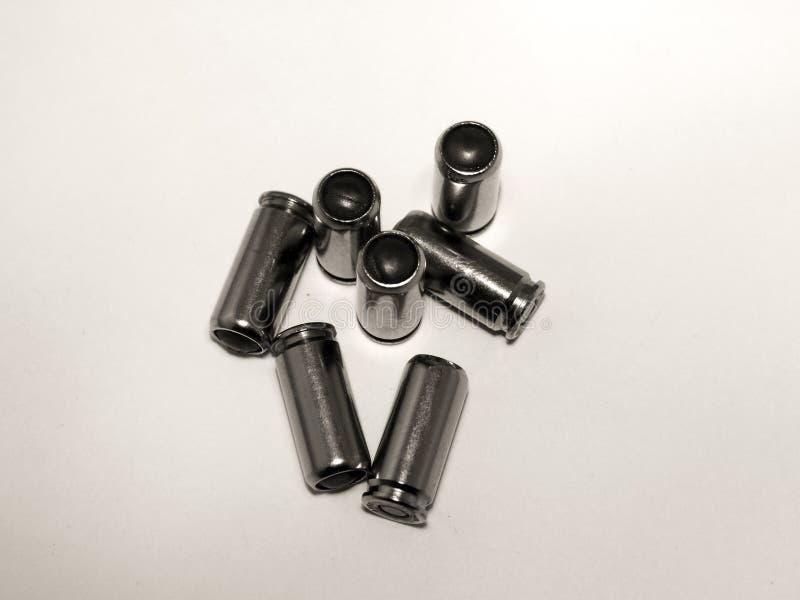 Balas da pistola em um fundo branco foto de stock