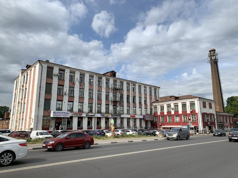 Balashikha, Moscow region, Russia, June, 14, 2019. Cars are near historical building of Balashikha cotton factory. Balashikha, Moscow region, Russia. Cars are stock photos