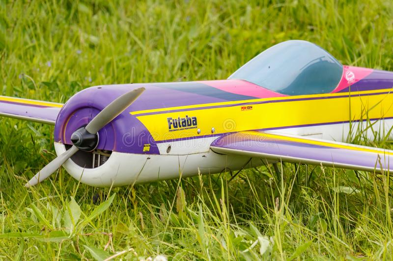 Balashikha, Moscow region, Russia - May 25, 2019: Big scale RC model of aerobatic aircraft with gasoline engine closeup on a green. Lawn. Aviation festival Sky royalty free stock image