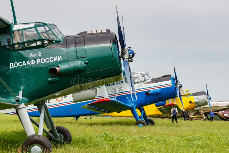 Balashikha, Moscow region, Russia - May 25, 2019: Legendary soviet aircraft biplane Antonov AN-2 parked on green grass of airfield. Against cloudy sky at royalty free stock photo