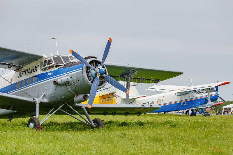 Balashikha, Moscow region, Russia - May 25, 2019: Legendary soviet aircraft biplane Antonov AN-2 parked on green grass of airfield. Against cloudy sky at stock photo