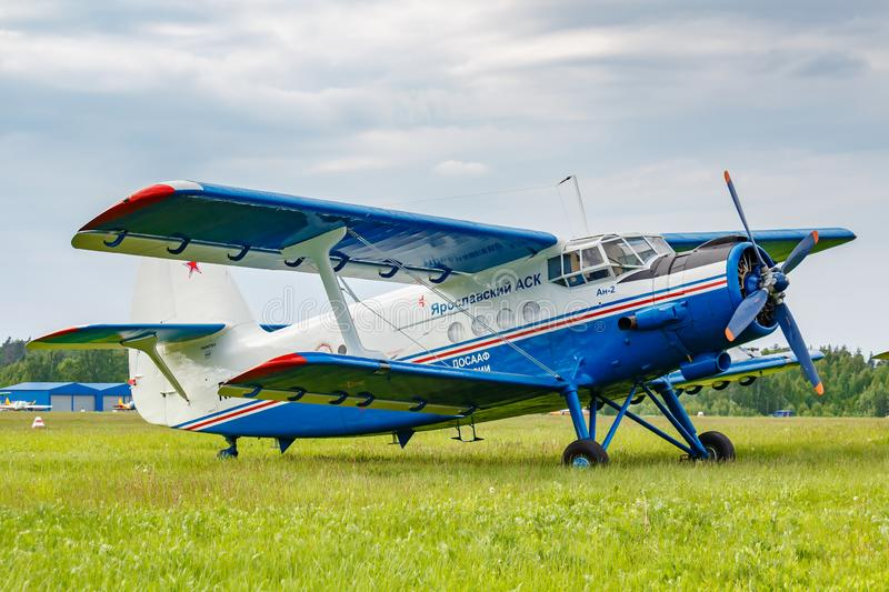 Balashikha, Moscow region, Russia - May 25, 2019: Legendary soviet aircraft biplane Antonov AN-2 parked on green grass of airfield. Against cloudy sky at stock photography