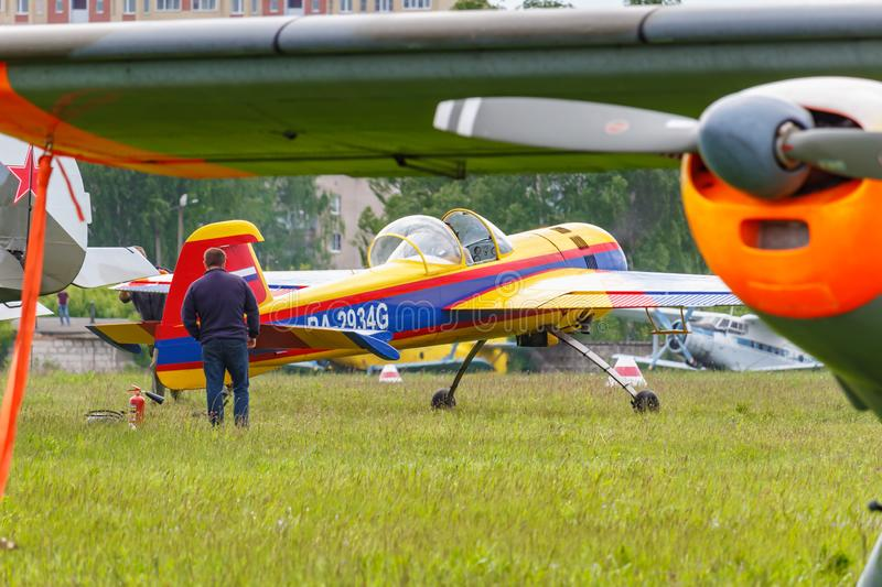 Balashikha, Moscow region, Russia - May 25, 2019: Russian sports and aerobatic aircraft SP-55F RA-2934G parked on a green grass of. Airfield Chyornoe at stock photos