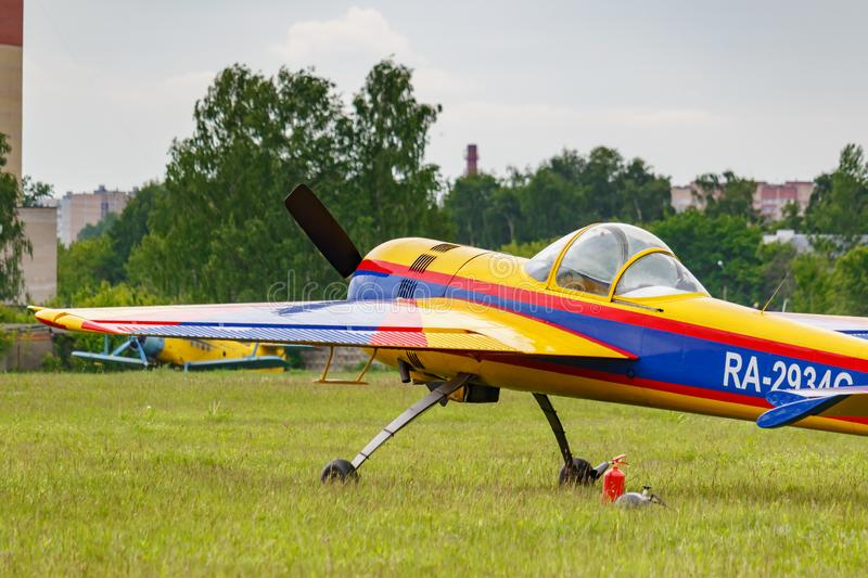 Balashikha, Moscow region, Russia - May 25, 2019: Russian sports and aerobatic aircraft SP-55F RA-2934G parked on a green grass of. Airfield Chyornoe at stock image