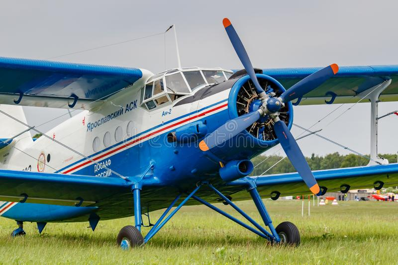Balashikha, Moscow region, Russia - May 25, 2019: White and blue soviet aircraft biplane Antonov AN-2 at parking on airfield. Against cloudy sky at Aviation royalty free stock image