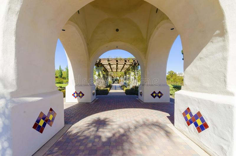 Balboa Park, San Diego, California. A view of the arched colorful mosaic architecture, pergola and beautiful garden in the Balboa Park in San Diego, California stock photography