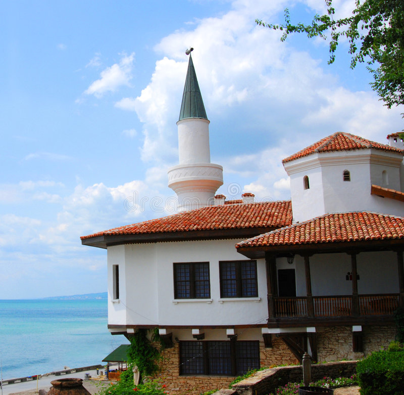 Balchik Palace. A view of the Balchik Palace in Bulgaria and its famous minaret, overlooking the sea nearby stock image